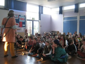 The children at Capel St Mary Primary listen to Jorun's weapons talk