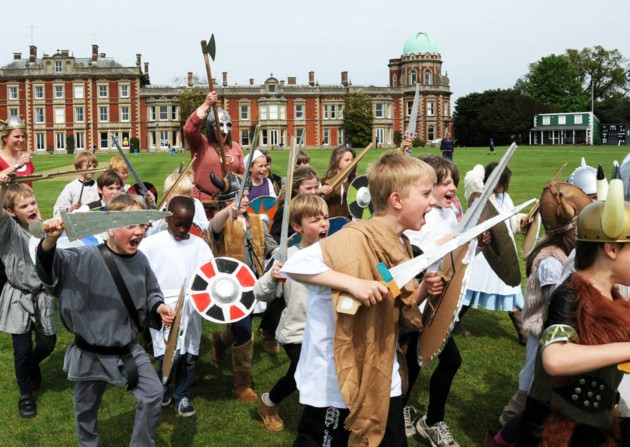 Children at Orwell Park School running into battle